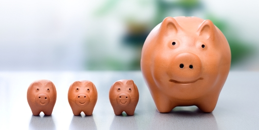Conceptual view of compound interest - big piggy-bank and the small ones