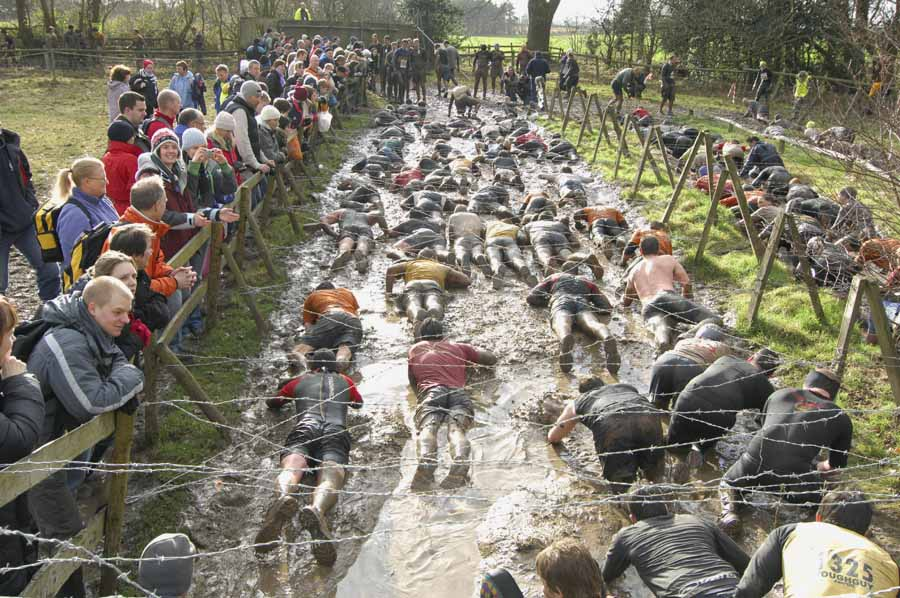 WOLVERHAMPTON, UNITED KINGDOM - JANUARY 27: Competitors tackle an obstacle course during the Tough Guy Challenge at South Perton Farm on January 27, 2008 near Wolverhampton, England.